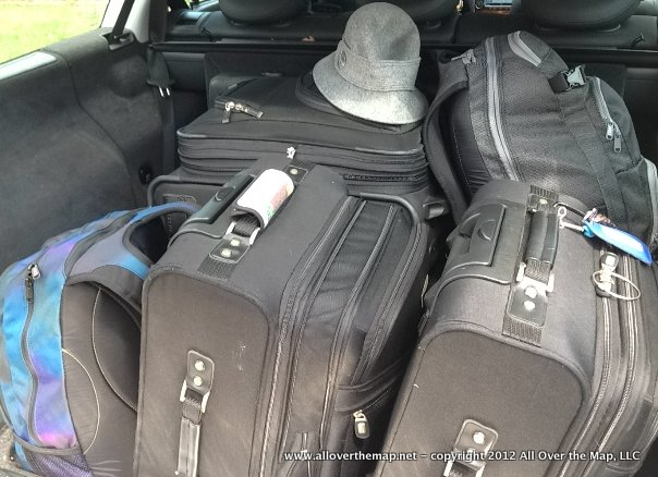 Packed for our family round-the-world trip - one small suitcase and one</a srcset=