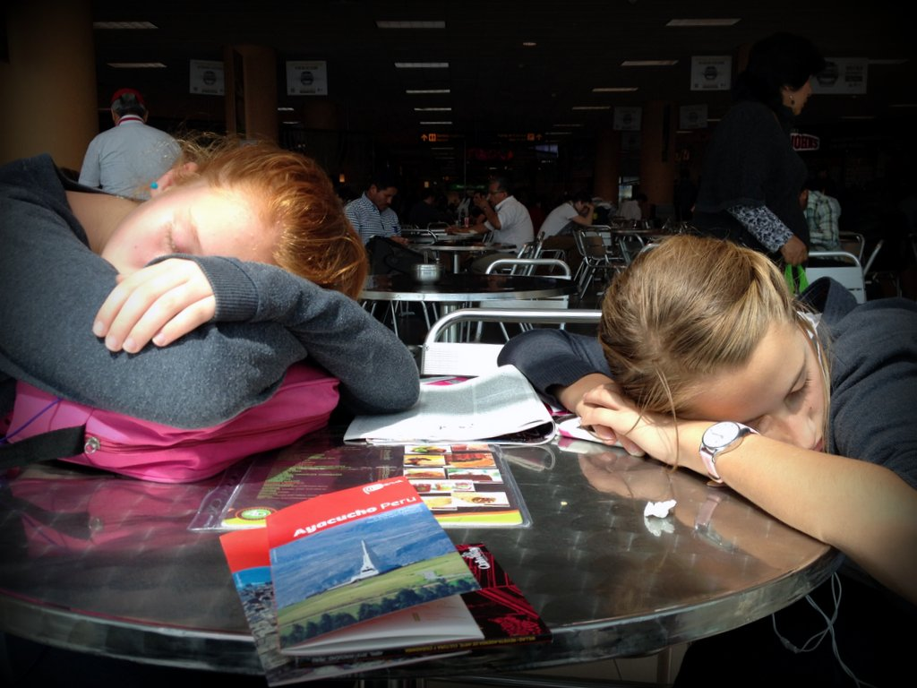 After a red-eye flight from Los Angeles, the girls sleep in the Lima airport.