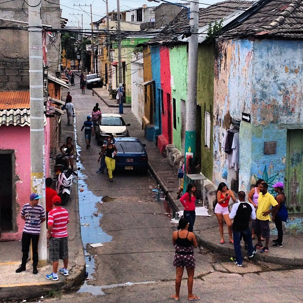 The neighborhood gathers for Sunday street baseball in the Getsemani neighborhood of Cartagena.