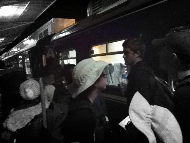 Teen getting on the night train in Aguas Calientes, Machu Picchu, Peru