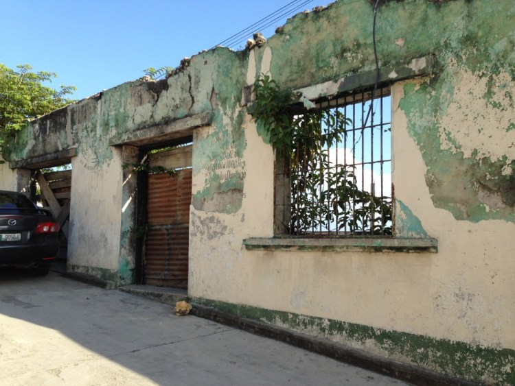 The scarred and crumbling remains of the school where R studied Spanish in San Andres, Guatemala.