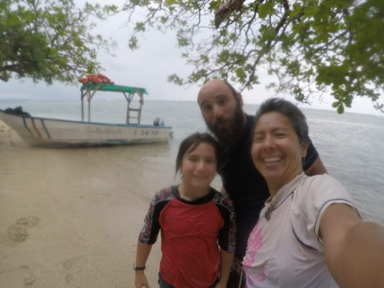 We survived our three-hour snorkeling tour unscathed. Coconut, noticeably absent from this photo, was the only casualty.