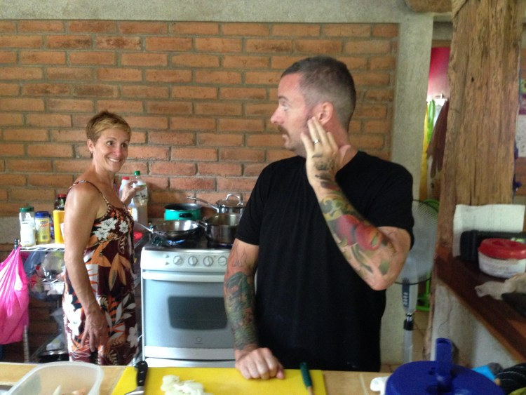 Marisa and Paul clown around in the kitchen of their rented home.