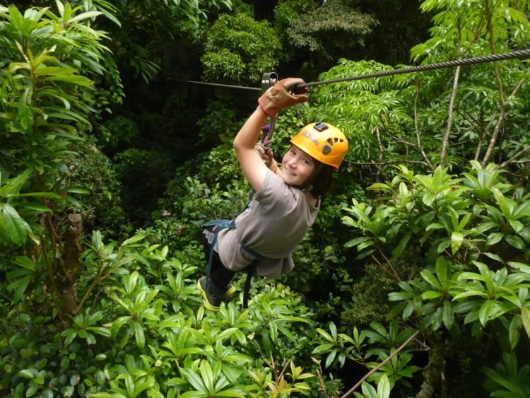 J zip lining into the cloud forest