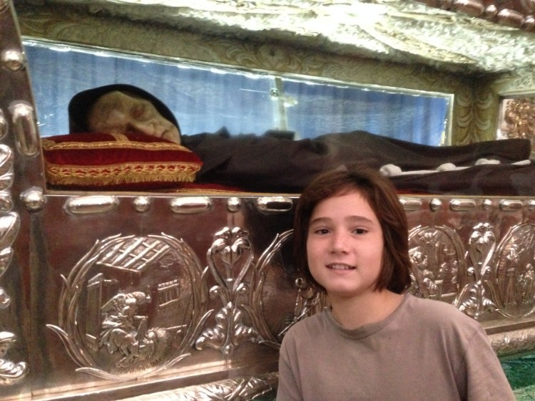 Jonah poses with the mummified remains of Sebastian de Aparicio, the protector of conducirs.
