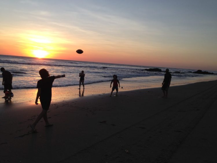Sunset football is a good way to have fun on the beach