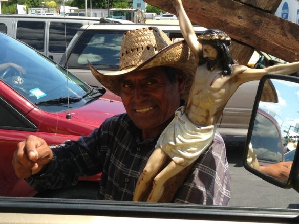 You can buy anything while waiting in traffic to cross the border, even a large wooden carving of Jesus on the cross.