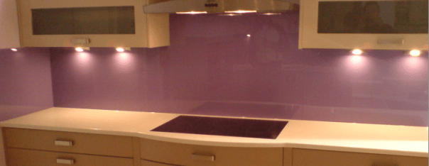 Purple Painted glass kitchen behind the Hob decourative glossy glass splash back