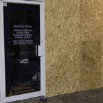 Broken door glass shop front window replacement glass emergency boarding up northern ireland glass and glazier Antrim glass