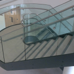 Architectural interior design curved glass stairs safety glass bespoke laminated safety glass and toughened glass balustrades glass ireland