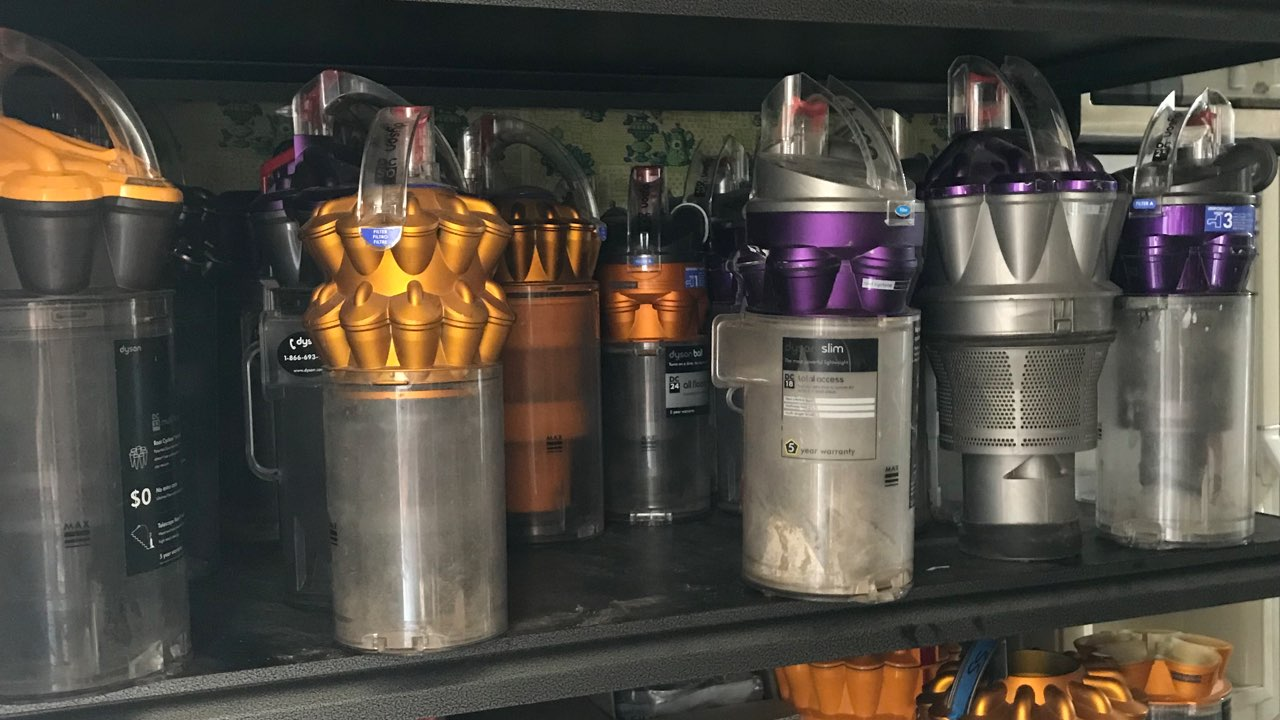 Dyson vacuum parts on shelf, cyclone, bin, prefilter