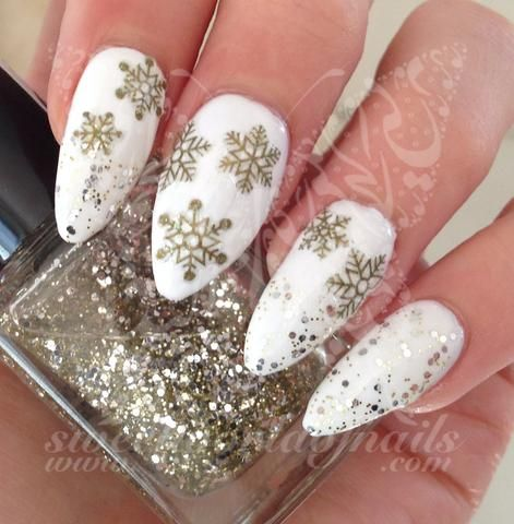 gold snowflake white nail art christmas design