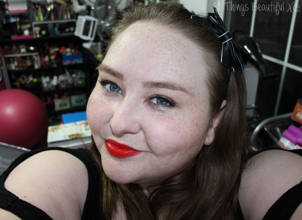 The Stila Stay All Day Vinyl Lip Gloss in Poppy Vinyl is Everything- the Stila Stay All Day Vinyl Lip Gloss in Poppy Vinyl is the perfect poppy red orange lip that will light up your makeup look! Demo & review on All Things Beautiful XO