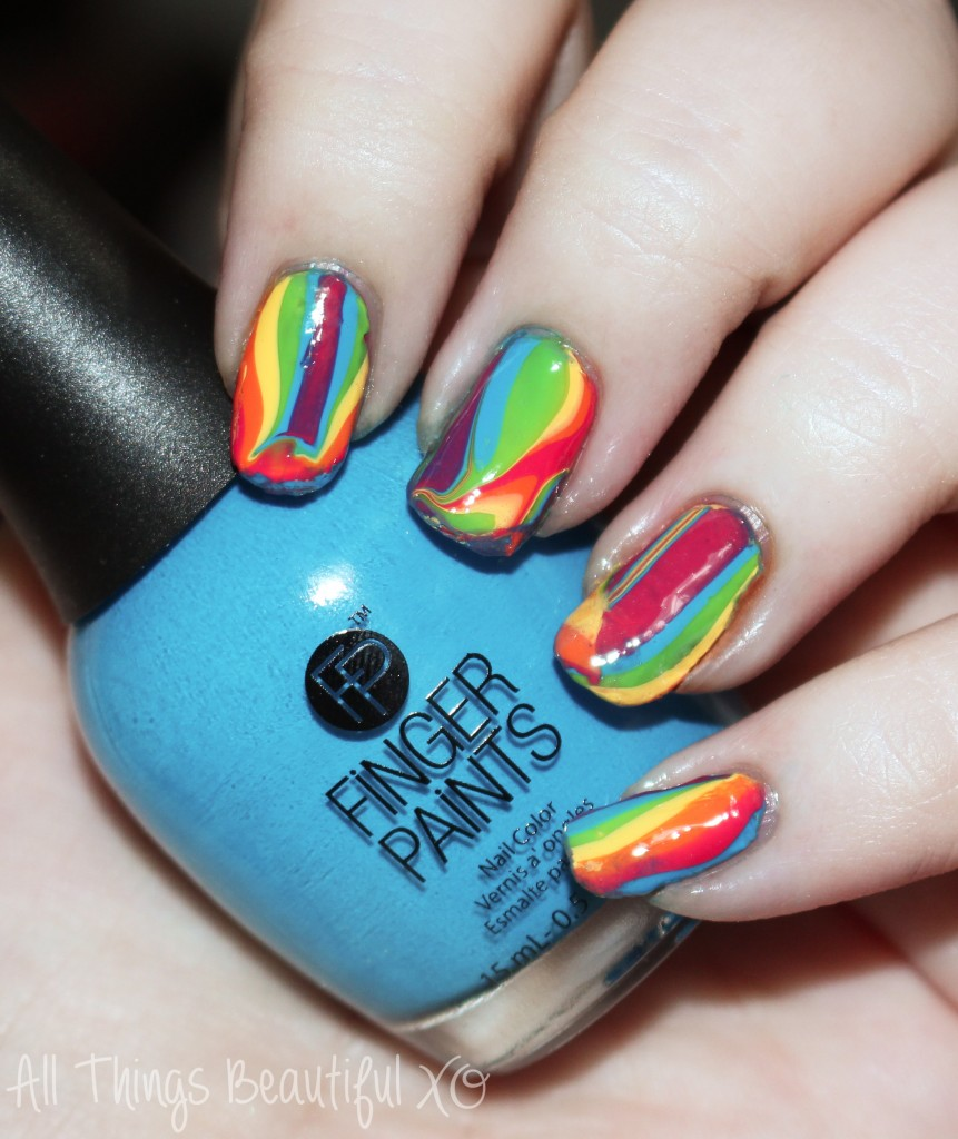 Check out this awesome water marble nail art using the Finger Paints Tie Dye Revolution Collection for Summer 2015 on All Things Beautiful XO | www.allthingsbeautifulxo.com