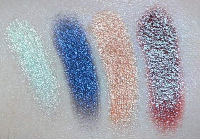 Swatches left to right of Butter London Eyeshadows in Sequins, Sapphire, Feather & Plume.  Swatches & review of the Butter London Shadow Clutch Palette in Natural Charm + the Interchangeable Duos in Fancy Flutter & Moody Blues. Customize it, primer infused, seriously pigmented & shadows that blend like a dream! Check it out on All Things Beautiful XO