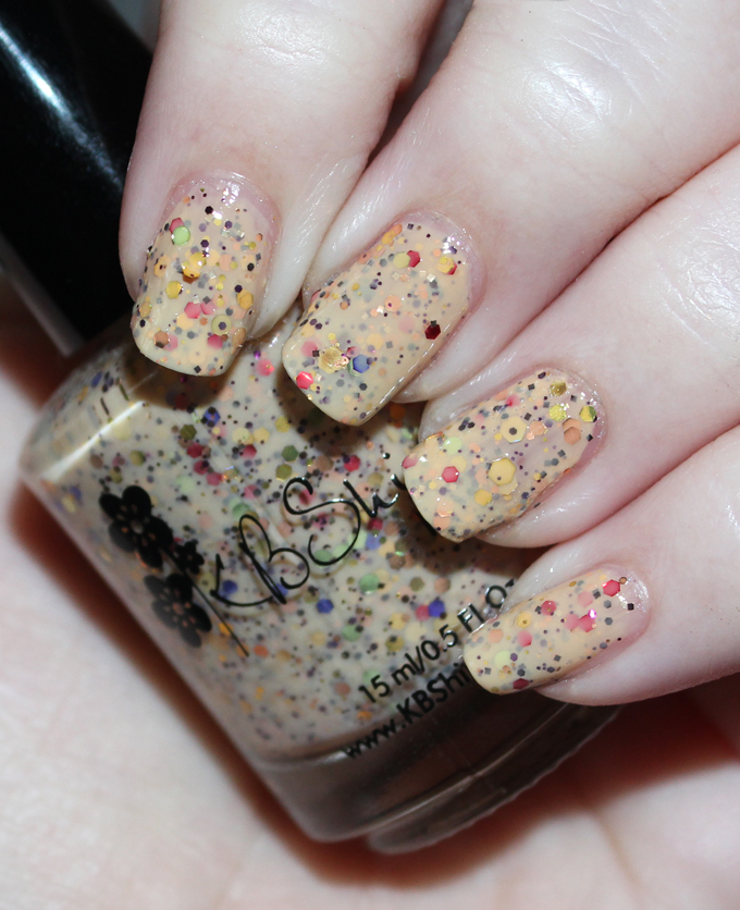 KBShimmer Winter Holiday Nail Polish Swatch in How Corn-y  Check out full swatches & review of all the KBShimmer Nail polish shades for winter/holiday- including some gorgeous holo & glitter options! Check them all out on All Things Beautiful XO