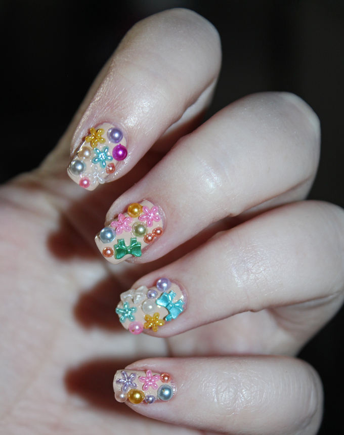 Spring has Sprung 3D Plastic Girly Nail Art with bows, pearls, & flowers- oh my! See more makeup, beauty, & nail posts on All Things Beautiful XO