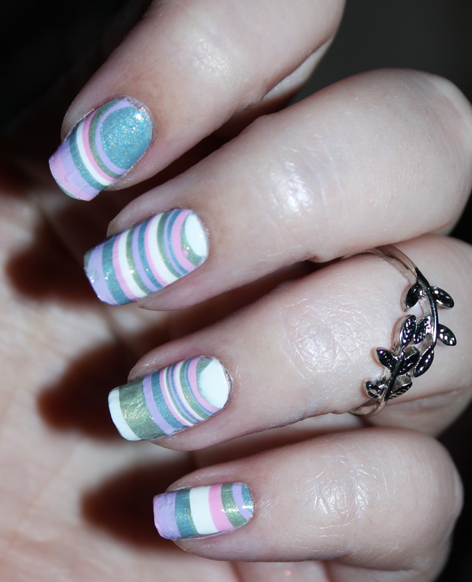 Easy DIY Watermarble Decal Pastel Stripes Nail Art Zoya Charming Collection including the shades Amira, Lacey, Abby, Jordan, & an opaque white. My easy water marble technique because I'm a cheater! See more nail art, makeup, & beauty posts on All Things Beautiful XO
