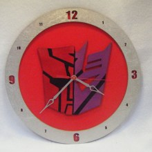 Autocon Transformers red background, 14 inch Build-A-Clock