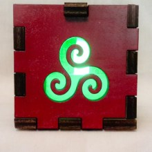 Triskele Red lit green