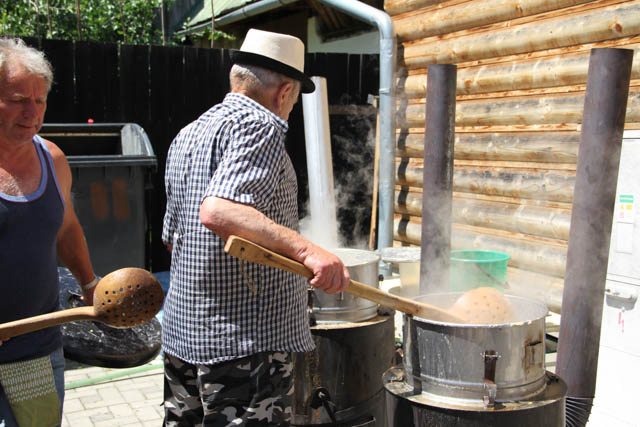 Men cooking gulky in Helpa, Slovakia