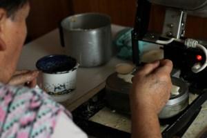 A woman makes Slovak oblatky
