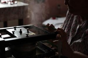 A wafer press hisses steam