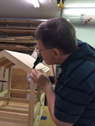 The shingles are glued and nailed like real shingles, hiding the nails.