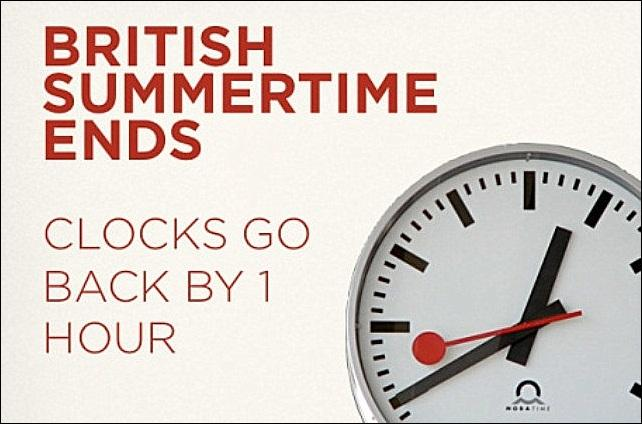 "An image of a clockface with the text ""British Summertime Ends: Clocks Go Back By 1 Hour"""