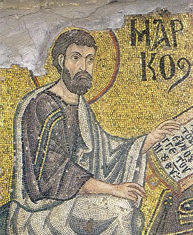 Mosaic depicting a man with a Gospel