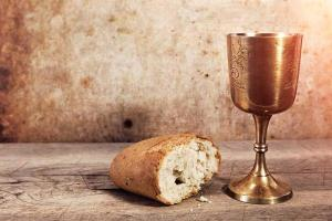 A photograph of a chalice and a loaf of bread