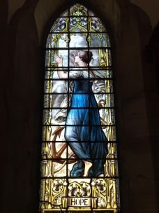 """Stained glass depiction of """"hope"""" at St Peter the Fisherman, Craster"""