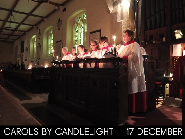 "A photograph of St Michael's robed choir holding candles with the words ""Carols by Candlelight 17 December"""