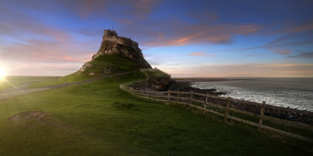 A photograph of the Holy Island of Lindisfarne at dusk