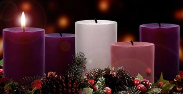 A photograph of three purple candles, one pink candle, and a white candle. The first purple candle is lit.
