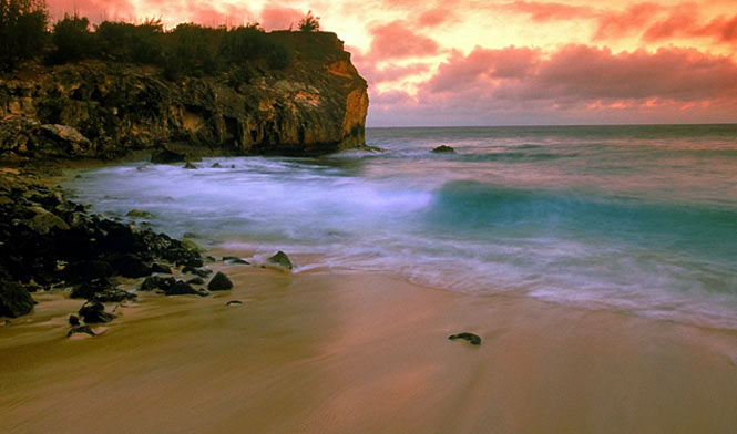 Shipwreck Beach at sunset, on Poipu in south Kauai