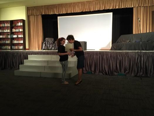 Theatre teacher presenting Tara w/ certificate