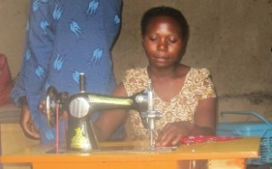 woman sewing in Uganda