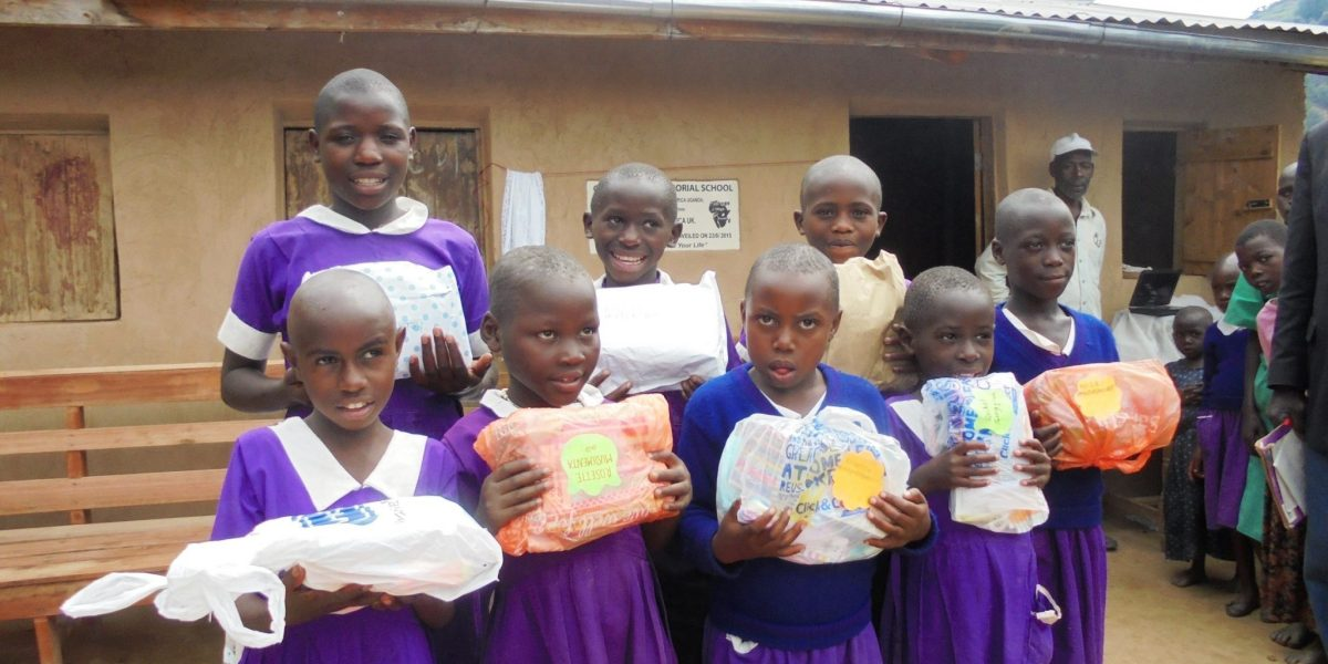Sponsored children with packages from their UK sponsors