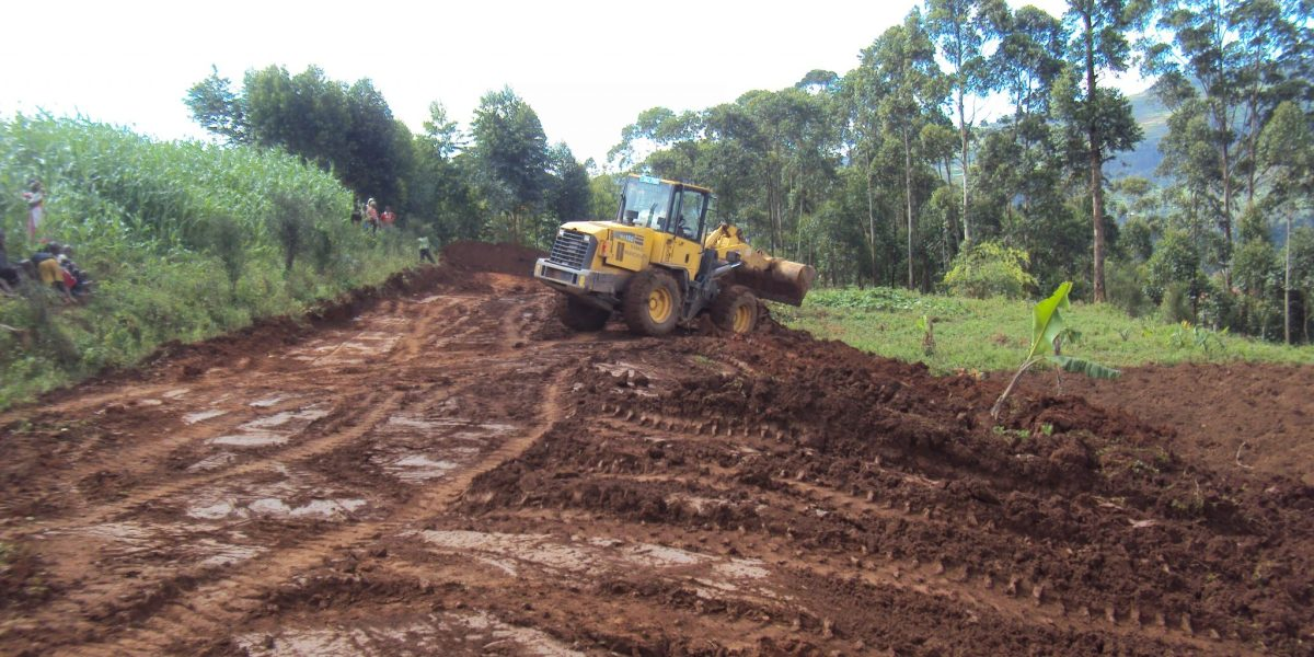 Tractor levelling the land