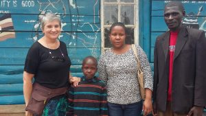 Alex arrives at Amazing Love School, with Peace, Monica and Headteacher Justus