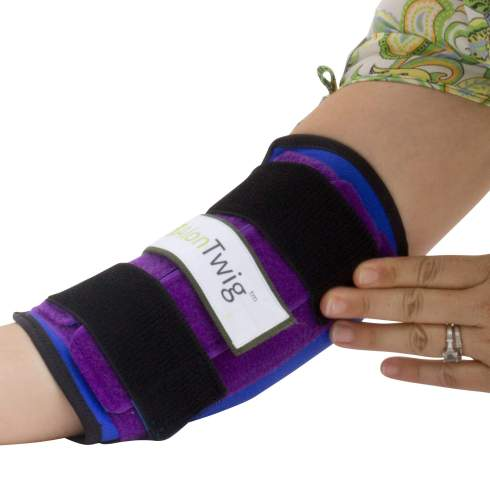 Putting on AlonTree Twig elbow brace with one hand