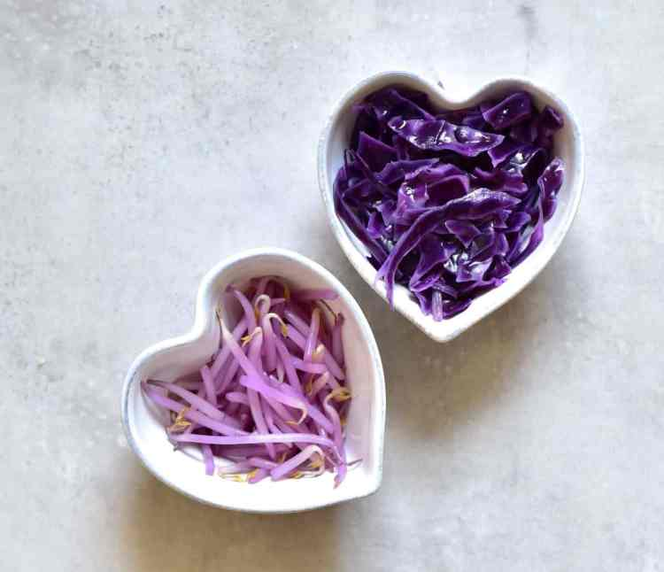 Mung bean sprouts tainted purple with red cabbage for vegetarian bibimbap