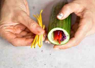 compiling the healthy 100% plant-based rainbow cucumber sushi rolls with an avocado dip. vegan, low-carb