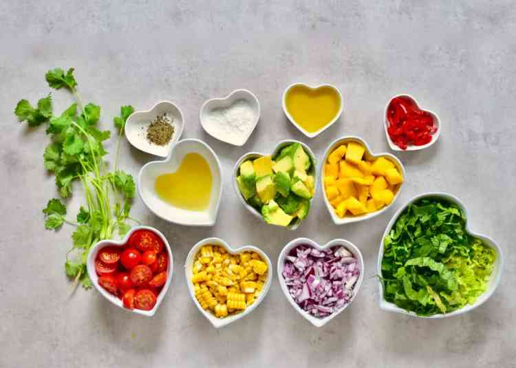 ingredients for the healthy rainbow summer salad with mango, sweetcorn and avocado. healthy bbq recipe