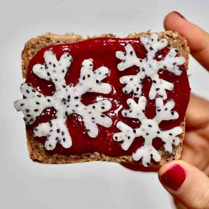 Christmas breakfast ideas perfect for christmas day breakfast - 9 healthy Christmas toast recipes including homemade nut butters, coconut yogurt and fruits. Plus these are easy Christmas recipes for Children - Using homemade cranberry sauce and dragonfruit snowflakes