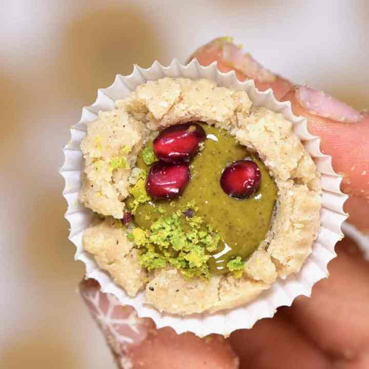 Delicious gluten-free, vegan bite-size snacks; almond & pistachio thumbprint cookies recipe. Not only are they easy to make- they can either be baked or kept as a no-bake cookie recipe!