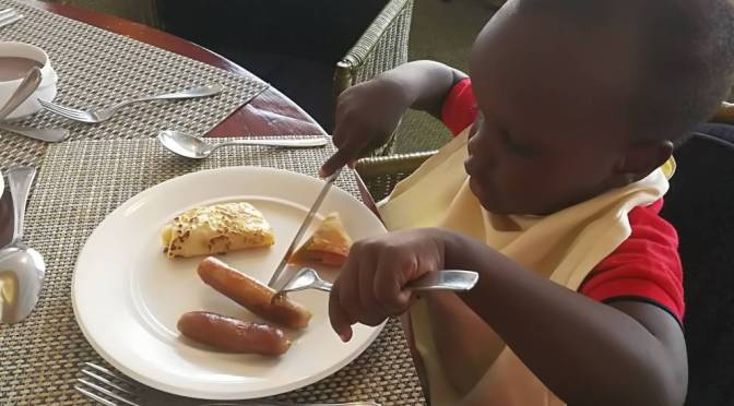 My son enjoying his New Year breakfast!