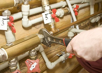 Plumber Servicing Water and Heating Systems
