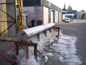 Testing-stainless-steel-tipping- Buckets-alpha-tanks